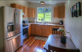The kitchen is modern and fully equipped